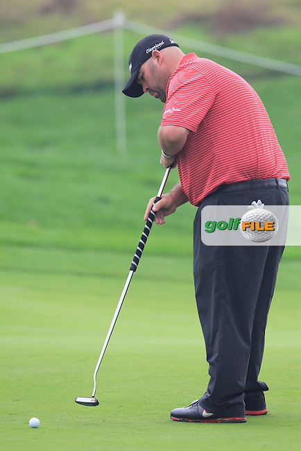 Kevin Stadler (USA) putts on the 5th green during Saturay's Round 3 of the 2014 BMW Masters held at Lake Malaren, Shanghai, China. 1st November 2014.<br /> Picture: Eoin Clarke www.golffile.ie