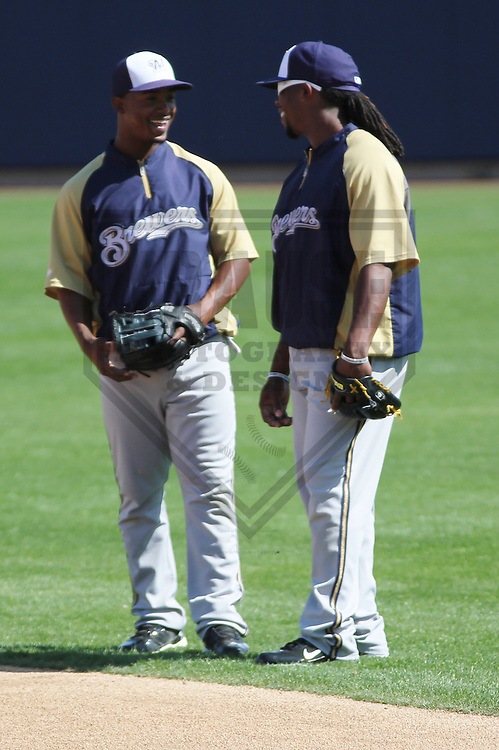 MARYVALE - March 2013: Jean Segura (9) and Rickie Weeks (23)  of the Milwaukee Brewers during a Spring Training practice on March 17, 2013 at Maryvale Baseball Park in Maryvale, Arizona. (Photo by Brad Krause).
