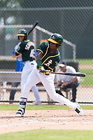 Oakland Athletics second baseman Marcos Brito (5) swings at a pitch during an exhibition game against Team Italy at Lew Wolff Training Complex on October 3, 2018 in Mesa, Arizona. (Zachary Lucy/Four Seam Images)