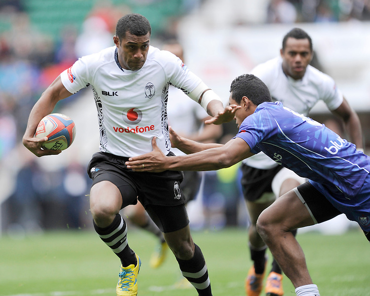 Samisoni Viriviri of Fiji is tackled by Tulolo Tulolo of Samoa during Day Two of the iRB Marriott London Sevens at Twickenham on Sunday 11th May 2014 (Photo by Rob Munro)