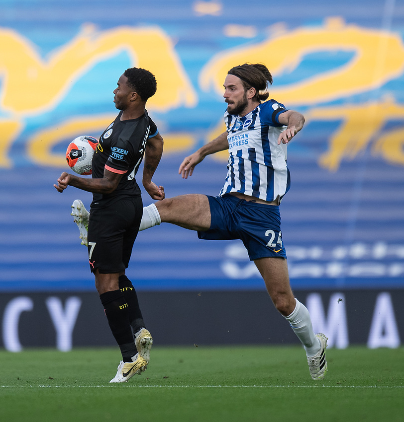 Manchester City's Raheem Sterling (left) is tackled by Brighton & Hove Albion's Davy Propper (right) <br /> <br /> Photographer David Horton/CameraSport<br /> <br /> The Premier League - Brighton & Hove Albion v Manchester City - Saturday 11th July 2020 - The Amex Stadium - Brighton<br /> <br /> World Copyright © 2020 CameraSport. All rights reserved. 43 Linden Ave. Countesthorpe. Leicester. England. LE8 5PG - Tel: +44 (0) 116 277 4147 - admin@camerasport.com - www.camerasport.com