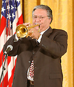 """Arturo Sandoval, Trumpet player performs """"America the Beautiful during a """"Celebration of National Hispanic Heritage Month"""" in the East Room of the White House in Washington, D.C. on October 12, 2001.                                                                                Credit: Ron Sachs / CNP."""