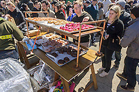 Foodies drool over Dough donuts on opening day at the premiere outdoor food court, Smorgasburg in East River State Park in the Williamsburg neighborhood of Brooklyn in New York on Saturday, April 4, 2015. The marketplace features prepared and artisanal foods made in Brooklyn by small entrepreneurs. The market has provided a venue for numerous chefs and cooks to sell their wares, some of whom have grown into large successful businesses. (© Richard B. Levine)