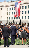 United States President Barack Obama and First Lady Michelle Obama speak with families of victims of the 9-11 attacks during a remembrance ceremony at the Pentagon in Washington, DC, on Sunday, September 11, 2011. .Credit: Joshua Roberts / Pool via CNP