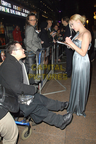 "SCARLETT JOHANSSON.Cinema & Television Benevolent Fund Royal Film Premiere 2007 of ""The Other Boleyn Girl"" held at.Odeon Leicester Square, London, England, February 19 2008..full length grey gray silver satin dress silk one shoulder  signing autograph for fan.CAP/CAS.?Bob Cass/Capital Pictures"