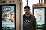 © Joel Goodman - 07973 332324 . 14/08/2015 . Hyde , UK . Customers using McDonalds' new order screen and waited table service at their branch in Mottram , Hyde . Photo credit : Joel Goodman