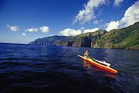 Local man paddling an outrigger canoe off the coast of Fatu Hiva, Marquesas, French Polynesia