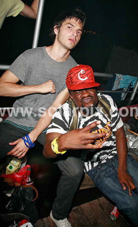 **ALL ROUND PICTURES FROM SOLARPIX.COM**.*WORLDWIDE RIGHTS*.Mark Ronson Ibiza Rocks VIP bar afterparty at VIP bar, Bar M, San Antonio, Ibiza, 24th July 2007..JOB REF:  4374  GMT   DATE: 24_07_2007..This pic: Alex Greenwald and Wale..**MUST CREDIT SOLARPIX.COM OR DOUBLE FEE WILL BE CHARGED* *UNDER NO CIRCUMSTANCES IS THIS IMAGE TO BE REPRODUCED FOR ANY ONLINE EDITION WITHOUT PRIOR PERMISSION*