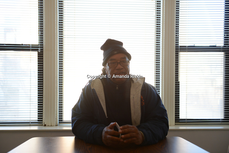 """Cease Fire supervisor Ulysses """"US"""" Floyd, an ex-high level Gangster Disciple, during a conversation with violence interrupters who work with Cease Fire, a public health initiative that attempts to halt or stop gun violence across the city, while briefing on recent developments in the neighborhoods where they work before setting out to canvass and meet with at risk youth participants in their office on the far South Side of Chicago, Illinois on February 3, 2017."""