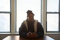 "Cease Fire supervisor Ulysses ""US"" Floyd, an ex-high level Gangster Disciple, during a conversation with violence interrupters who work with Cease Fire, a public health initiative that attempts to halt or stop gun violence across the city, while briefing on recent developments in the neighborhoods where they work before setting out to canvass and meet with at risk youth participants in their office on the far South Side of Chicago, Illinois on February 3, 2017."