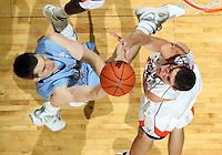 Jan. 8, 2011; Charlottesville, VA, USA;  North Carolina Tar Heels forward Tyler Zeller (44) is defended by Virginia Cavaliers guard Joe Harris (12) as he shoots the ball during the game at the John Paul Jones Arena. North Carolina won 62-56. Mandatory Credit: Andrew Shurtleff