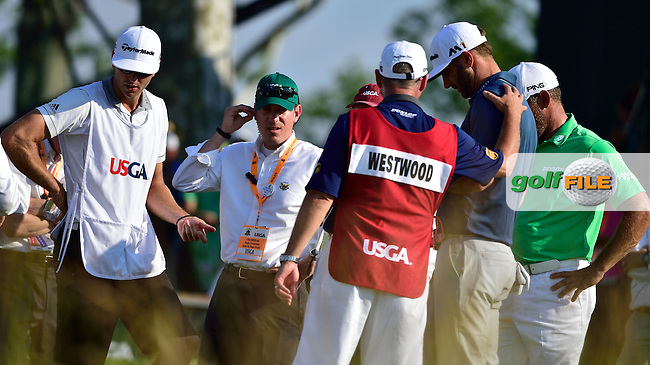 Referee explains to Dustin JOHNSON (USA) he may get a penalty for incident at 5th green as Lee WESTWOOD (ENG) listens in during fourth round 116th US Open 2016 ,Oakmont Country Club, Pittsburgh,Pennsylvania,USA.