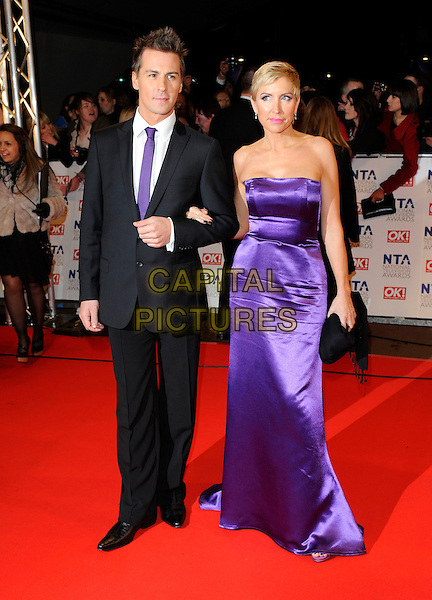 MATT EVERS & HEATHER MILLS .At the National Television Awards, held at O2 Arena, London, England, UK, January 20th 2010..arrivals TV NTA NTAs full length black suit tie Strapless purple long maxi dress clutch bag .CAP/FIN.©Steve Finn/Capital Pictures.