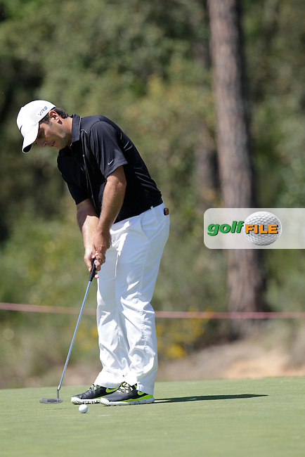 Francesco Molinari (ITA) putts on the 7th green during Thursday's Round 1 of the 2014 Open de Espana held at the PGA Catalunya Resort, Girona, Spain. Wednesday 15th May 2014.<br /> Picture: Eoin Clarke www.golffile.ie