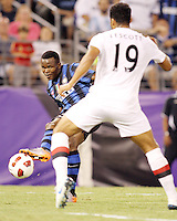 Nsofor Victor Obinna #33 of Inter Milan tweaks the ball off the leg of Jolson Lescott of Manchester City to score the second goal during an international friendly match on July 31 2010 at M&T Bank Stadium in Baltimore, Maryland. Milan won 3-0.