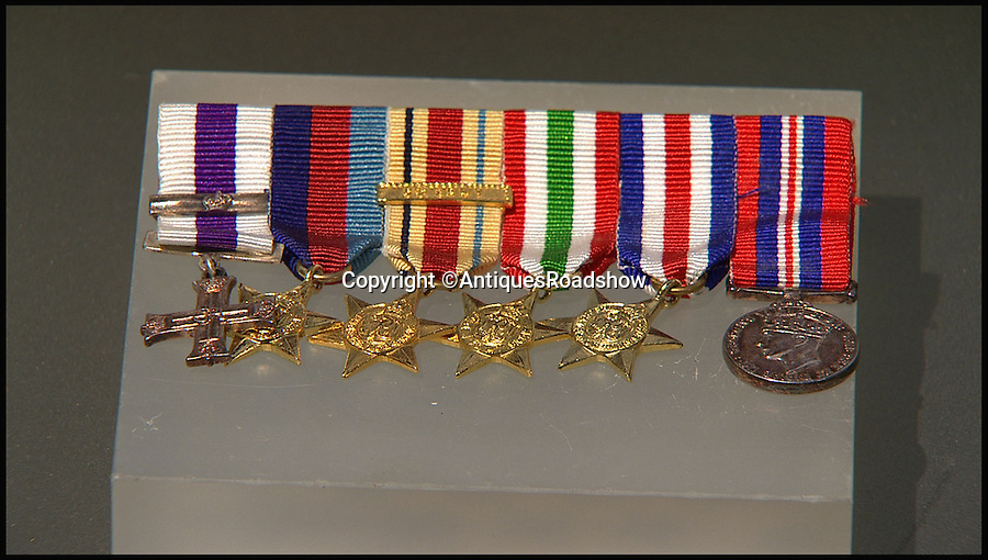 BNPS.co.uk (01202 558833)<br /> Pic: AntiquesRoadshow/BNPS<br /> <br /> ***Please Use Full Byline***<br /> <br /> (L-R): Military Cross with bar, 1939-45 Star, Africa Star with 8th Army clasp (the clasp was only awarded to those who served at El Alamein), Italy Star, France Germany Star and General Service Medal.<br /> <br /> Close ups of Roy's belongings that he took onto Antiques Roadshow. The episode will air this Sunday (23/11/14). <br /> <br /> The incredible story of how legendary German general Erwin Rommel spared the life of a captured British soldier and then served him a glass of beer has been revealed after 70 years.<br /> <br /> Captain Roy Wooldridge met Rommel after being taken prisoner in a dangerous night-time mission to examine submerged mines along the French beaches weeks before the D-Day landings.<br /> <br /> His story is to be told on BBC1's Antiques Roadshow this Sunday.