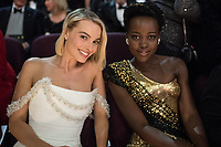 Oscar&reg; nominee for Actress in a Leading Role, Margot Robbie and Lupita Nyong'o at the 90th Oscars&reg; at the Dolby&reg; Theatre in Hollywood, CA on Sunday, March 4, 2018.<br /> *Editorial Use Only*<br /> CAP/PLF/AMPAS<br /> Supplied by Capital Pictures