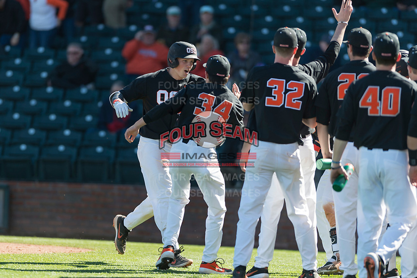 Oregon State Beavers catcher Adley Rutschman (35) celebrates with teammates after hitting a home run during a game against the Gonzaga Bulldogs on February 16, 2019 at Surprise Stadium in Surprise, Arizona. (Zachary Lucy/Four Seam Images via AP)