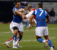 February 14 2009, San Diego, CA, USA:  The IRB USA Sevens Tournament at Petco Park in Downtown San Diego.  A Samoan player is tackled by an English player during day one action.