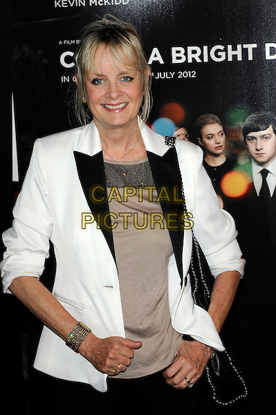 Twiggy Lawson.'Comes A Bright Day'  world film premiere, Curzon Mayfair, London, England..June 26th, 2012.half length black blazer white lapels beige top.CAP/CJ.©Chris Joseph/Capital Pictures.