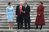 United States President Donald Trump and former US President Barack Obama stand on the steps of the U.S. Capitol with First Lady Melania Trump and Michelle Obamal on January 20, 2017 in Washington, DC. In today's inauguration ceremony Donald J. Trump becomes the 45th president of the United States. <br /> Credit: Rob Carr / Pool via CNP