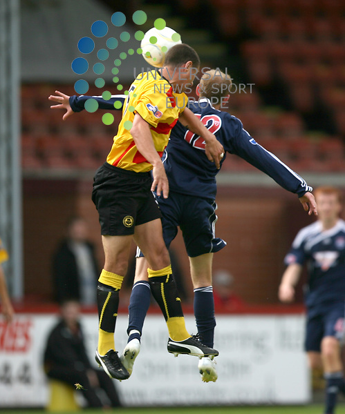 Particks John Robertson and countys John stewart battel in the air during the Partick Thistle v Ross County Irn-Bru Scottish League First Division at Firhill Stadium 15/08/09....Picture by Ricky Rae/ Universal News & Sport (Scotland).