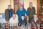 11yr old Ronan Magee(seated centre)from Knockgorm Tralee made all the right moves in becoming the overall winner of Tralee Chess Club senior league 2009/2010 season,also photographed at the Castle bar last Wednesday night were,Paul Shanahan(seated Lt)club treasurer and Padraig O'Sullivan(seated Rt)PRO,back L-R Joseph Doyle,Michael O'Meara(chairman)and Val Delaney(club secretary).