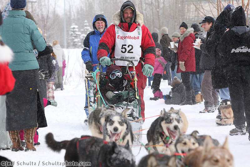 Matt Giblin Mushes through Bike/ski trail in midtown Anchorage, During the 2012 Iditarod ceremonial start..Britt Coon/Iditarodphotos.com.