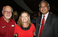 NWA Democrat-Gazette/CARIN SCHOPPMEYER  UA Chancellor Joe Steinmetz and his wife Sandy and Provost Ashok Saxena welcome new faculty at a reception Aug. 29 at Fowler House, the chancellor's residence on the UA campus in Fayetteville.