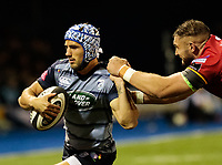 Cardiff Blues' Matthew Morgan under pressure from  Dragons' James Thomas<br /> <br /> Photographer Simon King/CameraSport<br /> <br /> Guinness Pro14 Round 6 - Cardiff Blues v Dragons - Friday 6th October 2017 - Cardiff Arms Park - Cardiff<br /> <br /> World Copyright &copy; 2017 CameraSport. All rights reserved. 43 Linden Ave. Countesthorpe. Leicester. England. LE8 5PG - Tel: +44 (0) 116 277 4147 - admin@camerasport.com - www.camerasport.co
