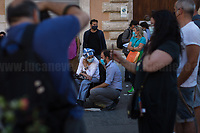 """Emma Bonino MP & Matteo Orfini MP.<br /> <br /> Rome, 27/07/2020. Today, hundreds of people, NGO's (ONG) representatives, actors and politicians gathered in Piazza San Silvestro (near the Italian Parliament) to protest (1.) against the dramatic situation in Libya - erupted in a civil war between the GNA (2.) and the forces of General Khalifa Belqasim Haftar - and to protest against the inhumane conditions of migrant people trapped in legal and illegal prisons in Libya. The aim of the demo was to call the Italian Government to stop funding the """"Libyan Coast Guard"""" and to immediately help and free People in Libya throughout """"Humanitarian Corridors"""", and give them the protection they are entitled of by the International Human Rights Conventions. <br /> From the organisers Facebook event page: «[…] we meet to ask the Italian Government and the European States to stop funding the so-called Libyan coast guard, to close and evacuate the detention centres by transferring migrants out of Libya and to promote corridors to help people on the run find protection without endangering their lives. The men, women and children who take the sea from the Libyan coast flee from situations of extreme misery, despotic regimes, tribal persecutions, ethnic conflicts, wars and environmental catastrophes. And in Libya they are subjected to violence, extortion, detention, torture, rape and torture. A few days ago, on July 16, the Chamber of Deputies [Of the Italian Parliament, ndr] for the fourth consecutive year approved the financing of the Italian mission in Libya, which provides financial support for the so-called Libyan coastguard and training and training of its members. […] The mobilization will be accompanied by readings by Ascanio Celestini, Valentina Carnelutti, Fabrizio Gifuni and Sonia Bergamasco […]».<br /> <br /> Footnotes & Links:<br /> 1. https://www.facebook.com/events/2732849460337428/<br /> 2. 07.05.19 Prime Minister of Libya Fayez al-Serraj Met Italian PM Giuseppe Conte at"""