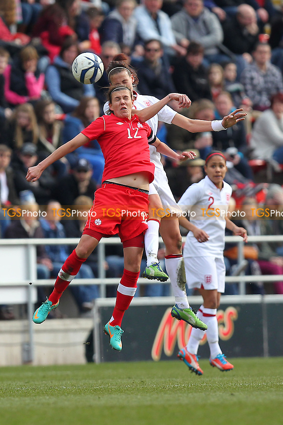 Jill Scott of England rises above Christine Sinclair of Canada - England Women vs Canada Women - International Football Friendly Match at the New York Stadium, Rotherham United FC - 07/04/13 - MANDATORY CREDIT: Gavin Ellis/TGSPHOTO - Self billing applies where appropriate - 0845 094 6026 - contact@tgsphoto.co.uk - NO UNPAID USE.