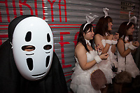 A person dressed as a no face from the animation, Spirited Away during the Halloween celebrations in Shibuya, Tokyo, Japan. Wednesday October 31st 2018 .  Halloween has grown massively popular  in Japan over the last few yers. Primarily an event for young adults who use it as a chance to dress up in inventive costumes and spend the night partying . In recent years the misbehaviour of some revellers has caused a heavier police presence on the street and  a push back from the Japanese society, and media  who see no need for nor benefits to this western cultural import.