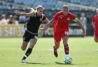 Leslie Osborne (10) battles against Abby Wambach (20). FC Gold Pride defeated Washington Freedom 3-2 at Buck Shaw Stadium in Santa Clara, California on August 1, 2009.