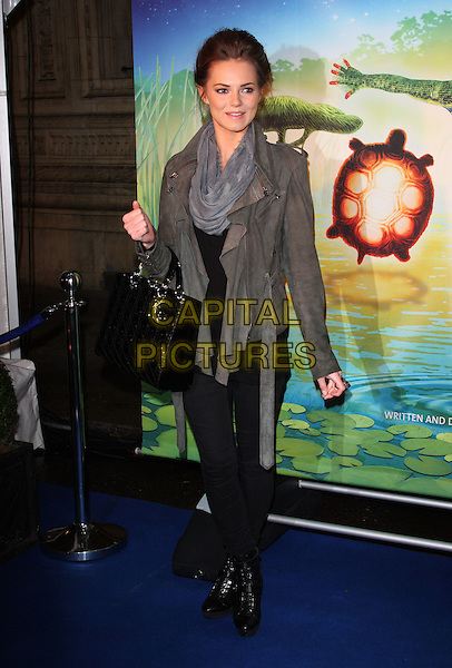 KARA TOINTON .UK Premiere of Cirque du Soleil's 'Totem' at the Royal Albert Hall, London, England, UK, January 5th 2011..Full length black grey gray bag jacket scarf leather suede Dior hand bag leggings boots .CAP/ROS.©Steve Ross/Capital Pictures