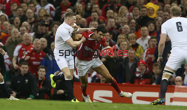 Mike Phillips tries to shrug off Chris Ashton..2013 RBS 6 Nations Championship.Wales v England.Millennium Stadium.16.03.13.Credit: Steve Pope- Sportingwales