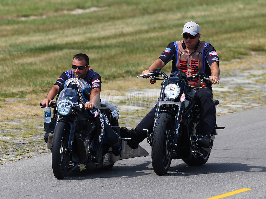 Aug. 31, 2013; Clermont, IN, USA: NHRA pro stock motorcycle rider Eddie Krawiec (left) with Matt Hines during qualifying for the US Nationals at Lucas Oil Raceway. Mandatory Credit: Mark J. Rebilas-