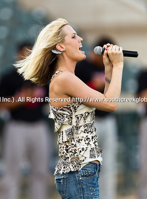 Danielle Sons sings the National Anthem before the American Association of Independant Professional Baseball game between the El Paso Diablos and the Fort Worth Cats at the historic LaGrave Baseball Field in Fort Worth, Tx. El Paso defeats Fort Worth 6 to 1.