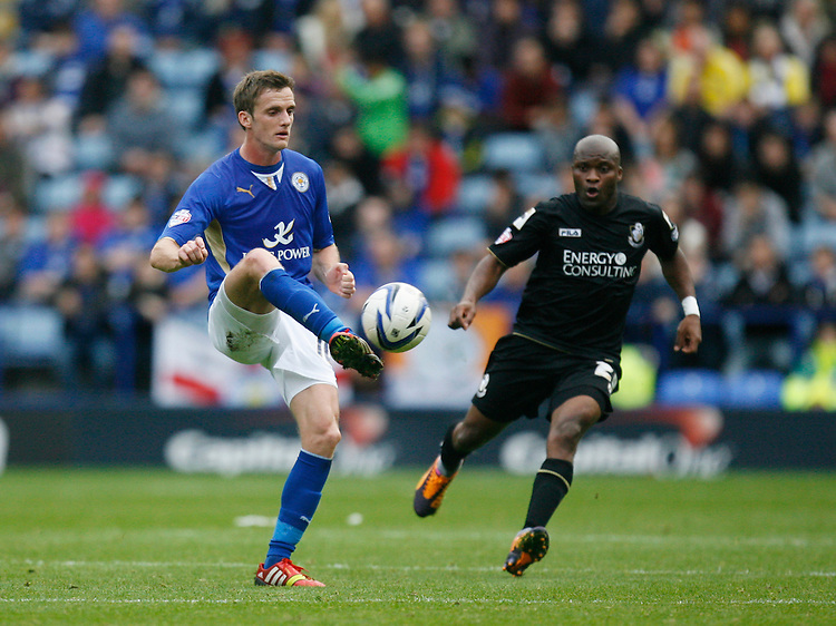 Leicester City's Andy King (L) and Bournemouth's Tokelo Rantie in action during todays match  <br /> <br /> Photo by Jack Phillips/CameraSport<br /> <br /> Football - The Football League Sky Bet Championship - Leicester City v Bournemouth - Saturday 26th October 2013 - King Power Stadium - Leicester<br /> <br /> &copy; CameraSport - 43 Linden Ave. Countesthorpe. Leicester. England. LE8 5PG - Tel: +44 (0) 116 277 4147 - admin@camerasport.com - www.camerasport.com