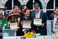 BALTIMORE, MD - MAY 21: (L-R) Exaggerator jockey Kent J. Desormeaux, trainer Keith Desormeaux, and owner Matt Bryan display their Longines watches after winning the 141st running of the Preakness Stakes at Pimlico Race Course on May 21, 2016 in Baltimore, Maryland. (Photo by Sue Kawczynski/Eclipse Sportswire/Getty Images)