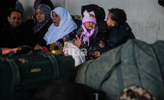 Palestinians wait for travel permits to cross into Egypt through the Rafah border crossing after it was opened by Egyptian authorities for humanitarian cases, in Rafah in the southern Gaza Strip, on January 31, 2017. Photo by Mohammed Dahman