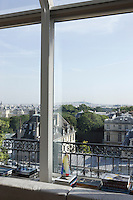A view of the city of Paris from the living room window