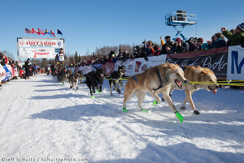 Mats Pettersson runs down the start chute lined with spectators during the Ceremonial Start of the 2016 Iditarod in Willow, Alaska.  March 06, 2016