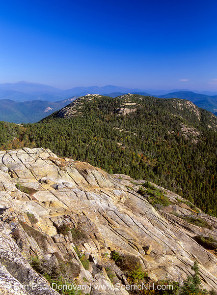 Scenic views of Three Sisters from the summit of Mount Chocorua in the White Mountains, New Hampshire USA. The summit of Mount Chocorua (foreground) is a subalpine rocky bald community.