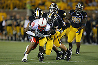 MU linebacker Sean Weatherspoon tackles Nebraska Cornhuskers wide receiver Maurice Purify during the first half at Memorial Stadium in Columbia, Missouri on October 6, 2007. The Tigers won 41-6.
