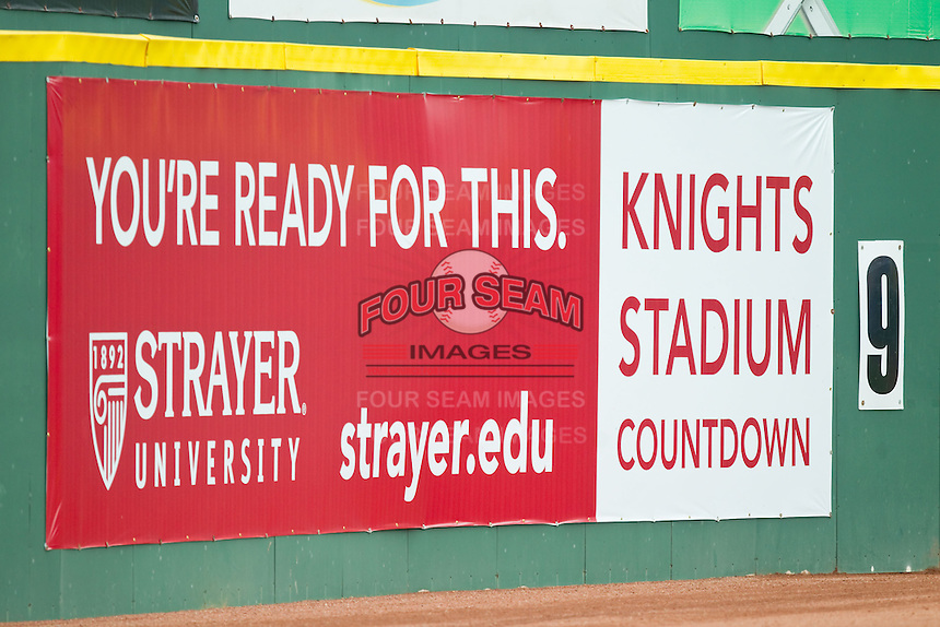 A sign on the left field wall counts down the number of home games remaining at Knights Stadium on August 18, 2013 in Fort Mill, South Carolina.  The Knights will be moving into a brand new ballpark in Uptown Charlotte for the 2014 season.  (Brian Westerholt/Four Seam Images)