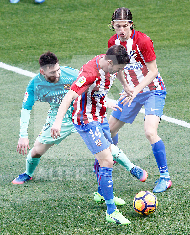Atletico de Madrid's Gabi Fernandez (c) and Filipe Luis (r) and FC Barcelona's Leo Messi during La Liga match. February 26,2017. (ALTERPHOTOS/Acero)