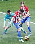 Atletico de Madrid's Gabi Fernandez (c) and Filipe Luis (r) and FC Barcelona's Leo Messi during La Liga match. February 26,2017. (ALTERPHOTOS/Acero)