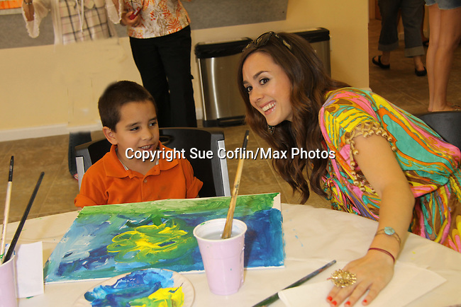 All My Children Christina Lind paints with Anthony at the Painting Party on May 15, 2011 on Marco Island, Florida - SWSL Soapfest Charity Weekend May 14 & !5, 2011 benefitting several children's charities including the Eimerman Center providing educational & outreach services for children for autism. see www.autismspeaks.org. (Photo by Sue Coflin/Max Photos)