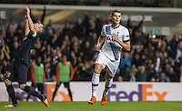 Erik Lamela of Tottenham Hotspur turns to celebrate scoring a hat trick as Jeremy Toulalan of Monaco looks devastated during the UEFA Europa League group match between Tottenham Hotspur and Monaco at White Hart Lane, London, England on 10 December 2015. Photo by Andy Rowland.